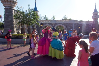 Cinderella's stepsisters and stepmother delighting guests out in the open.